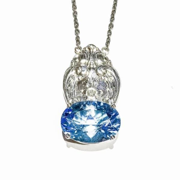 Sterling Silver 18x13mm Oval Blue Topaz Spoon Pendant with Diamond | Salvaged | Marvin Scott & Co.
